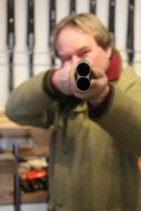 Holding an over and under shotguns